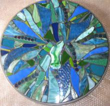 Mixed blue and green glass mosaic outdoor table