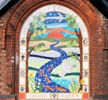 Mosaic Mural in A bricked up Gothic Arch Church doorway