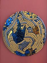 Gold Rush- Mosaic made on 35 cm diameter MDF with glass and metallic tiles gold and blue shards of Gold is associated with  winning such as gold medals and gold stars.In the context of religion golden robes adorn deities. Gold also symbolizes stability in many cultures, and is  associated i with  achievement, stability , sustainability and security