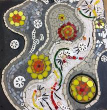 Indian  and continental wedding symbolism on slate. The inspiration for this piece comes from my two cultures and draws on the diversities and commonalitiesassociated with weddings on all continents. Use of bangles, marigold flowers the colour red , yellow and white, rice, shells and walking on a path are conceptualised in this piece which is created on slate